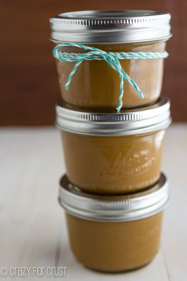 DIY Dulce de Leche packaged in tiny Mason Jars with a teal string bow tied around one