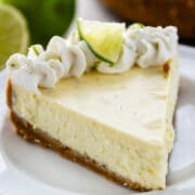 slice of key lime cheesecake on white plate