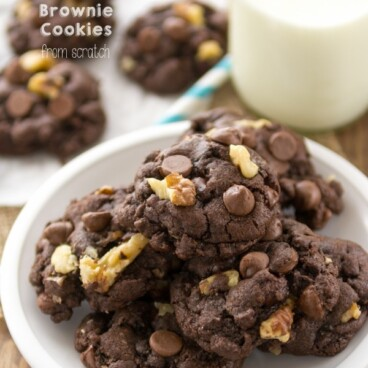 chocolate cookies with nuts on white plate