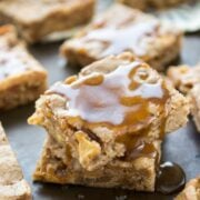blondies in a stack with caramel drizzled over