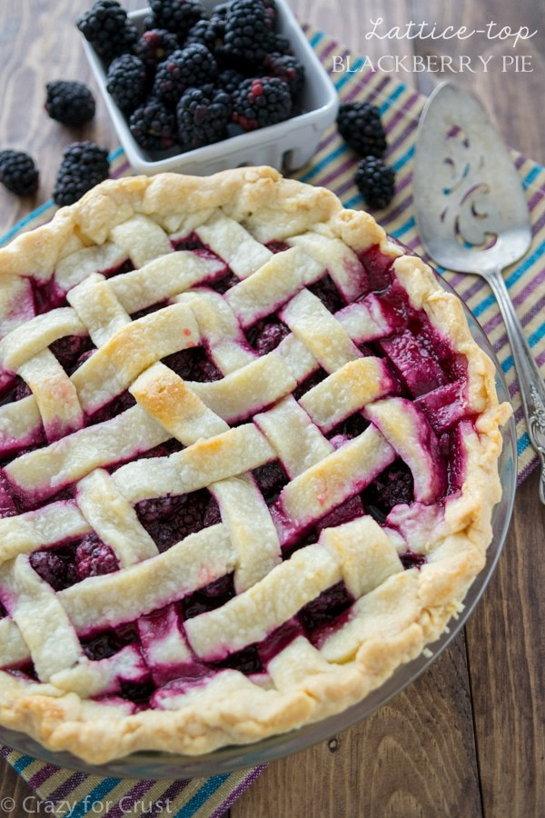 Blackberry Pie with a lattice top and a bowl of blackberries