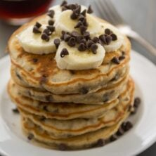 stack of banana pancakes with bananas and chocolate chips