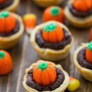 mini brownie pie with crust and candy pumpkin on top