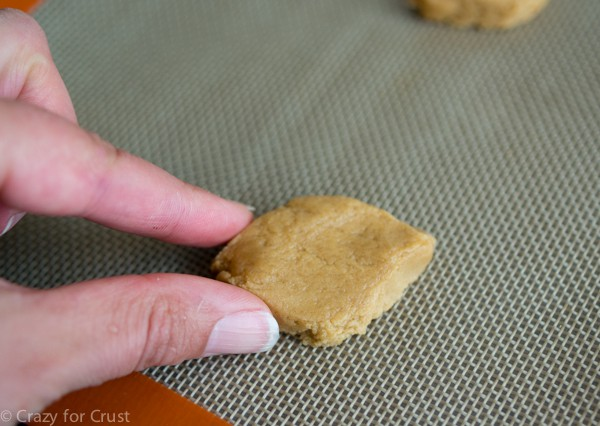 shaping cookie dough into peanut butter footballs