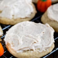closeup of pumpkin spice sugar cookie with frosting