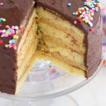 yellow cake with peanut butter filling and chocolate frosting with slice missing