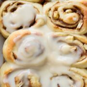 overhead shot of cinnamon rolls in pan with icing