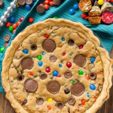 overhead shot of candy bar pie with candy behind