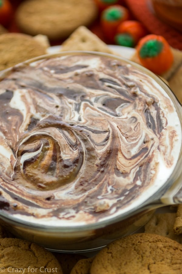 Pumpkin S'mores Dip has pumpkin pie, chocolate ganache, and marshmallow all in one warm dip!