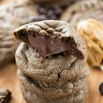 Chocolate Peanut Butter Truffle Cookies have a soft, gooey chocolate peanut butter truffle center.