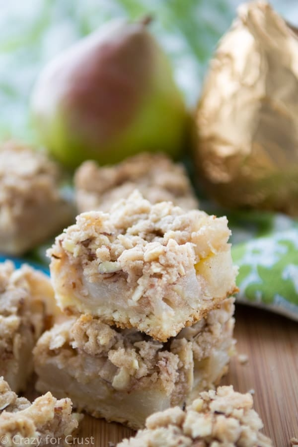 Pear Pie Crumble Bars are the perfect pie bar recipe, made with a shortbread crust, and almond crumble topping, and filled with sweet pears! They're perfect topped with caramel sauce!