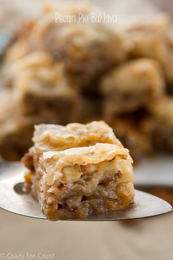 Pecan Pie Baklava sitting on a spatula with writing