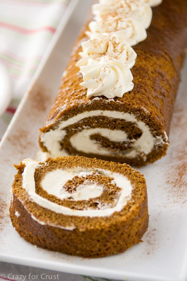 cake roll with filling on white plate