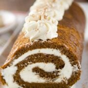 This Gingerbread Cake Roll is a divine blend of gingerbread and eggnog all into one beautiful roll.