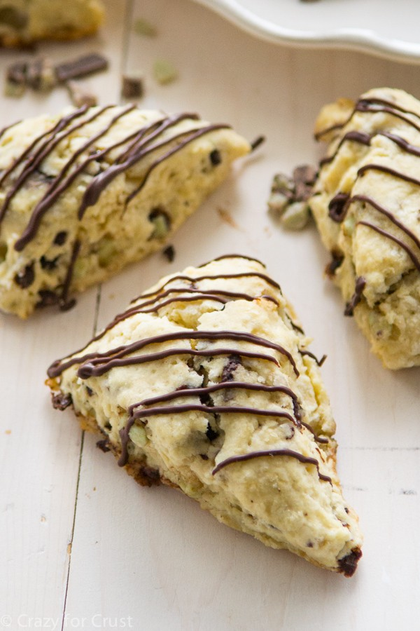 The perfect Mint Chip Scones! This recipe produces soft and pillowy scones, filled with mint chip pieces and chocolate!