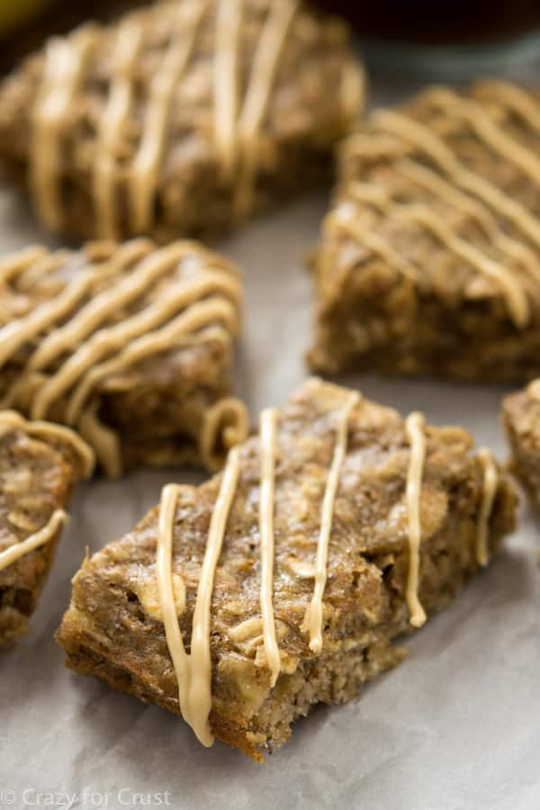 Banana Breakfast Bars with a peanut butter drizzle in a single layer on a platter