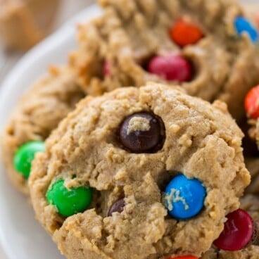 White plate full of Gluten Free Monster Cookies