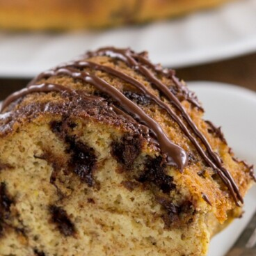 Healthier Chocolate Chip Cake on a white plate with a fork