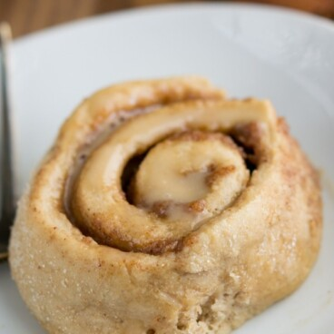 Healthier Cinnamon Roll on a white plate