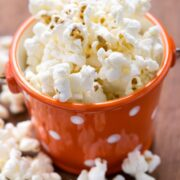 Skinny Sugar Free Kettle Corn in an orange and white polka dot cup