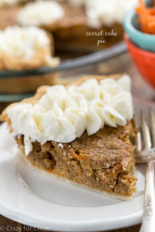 Carrot cake pie slice on a white plate with a fork
