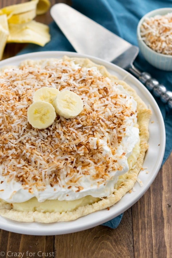 Banana Cream Pie on a white plate with a spatula
