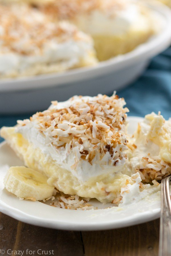 Coconut Banana Cream Pie sitting on a white plate