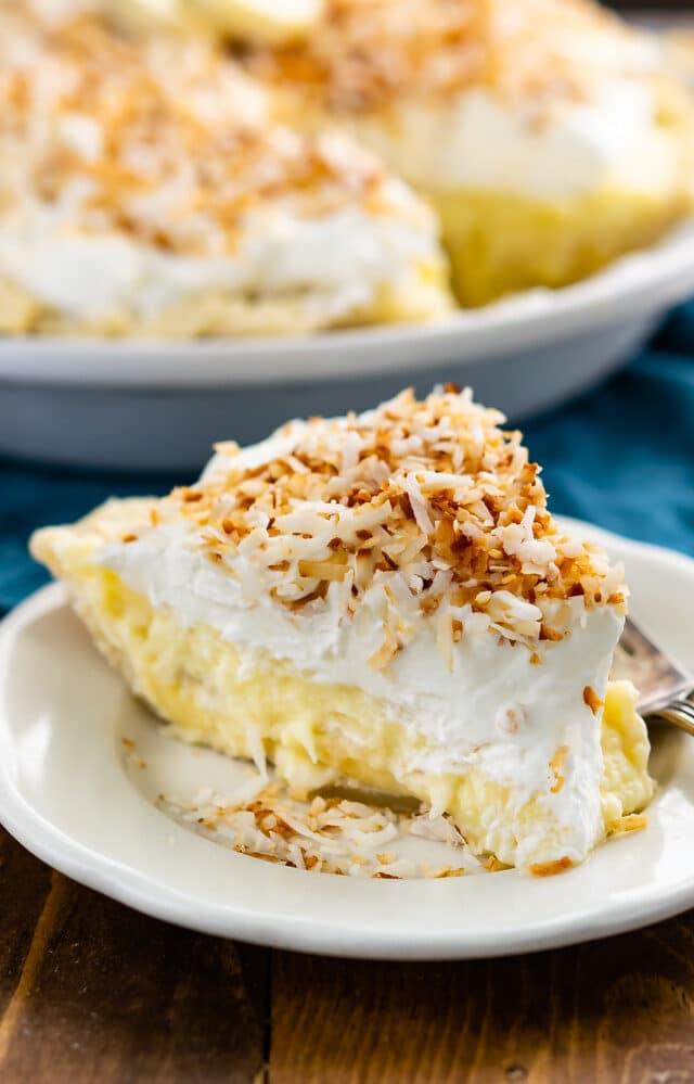 slice of coconut banana cream pie on white plate