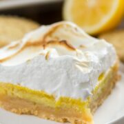 Slice of Lemon Meringue Pie Bars with Shortbread Crust on a white plate