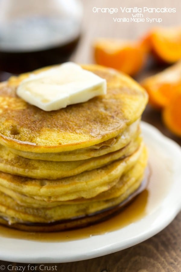 stack of orange pancakes on white plate
