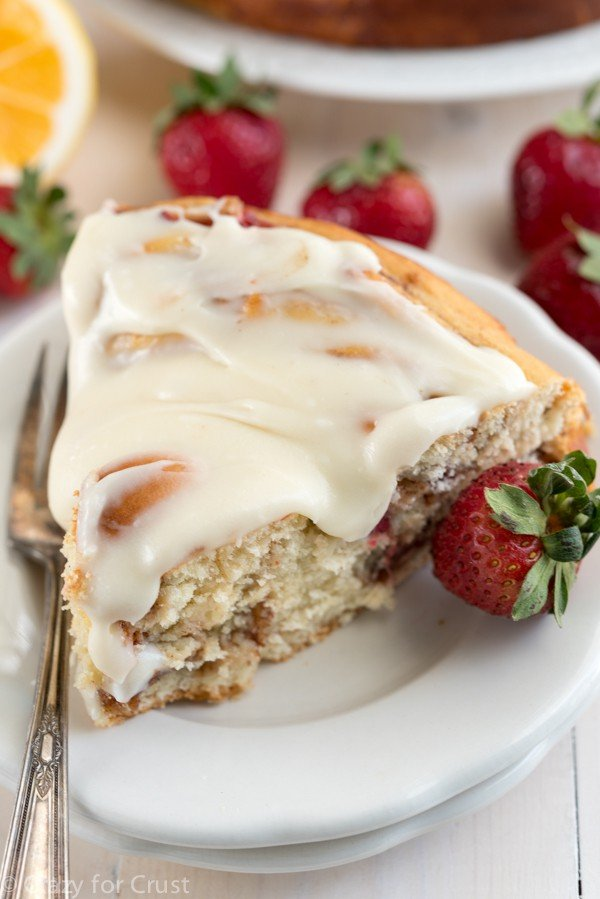 Giant Strawberry Cinnamon Roll Cake Recipe made with fresh strawberries and lemon cream cheese icing!