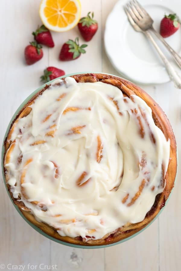 Giant Strawberry Cinnamon Roll Cake Recipe made with fresh strawberries and lemon cream cheese icing!