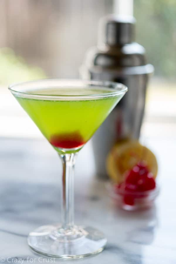 Midori Martini in a martini glass with a cherry