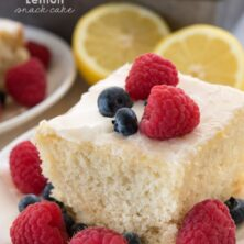 Slice of lemon snack cake topped with blueberries and raspberries