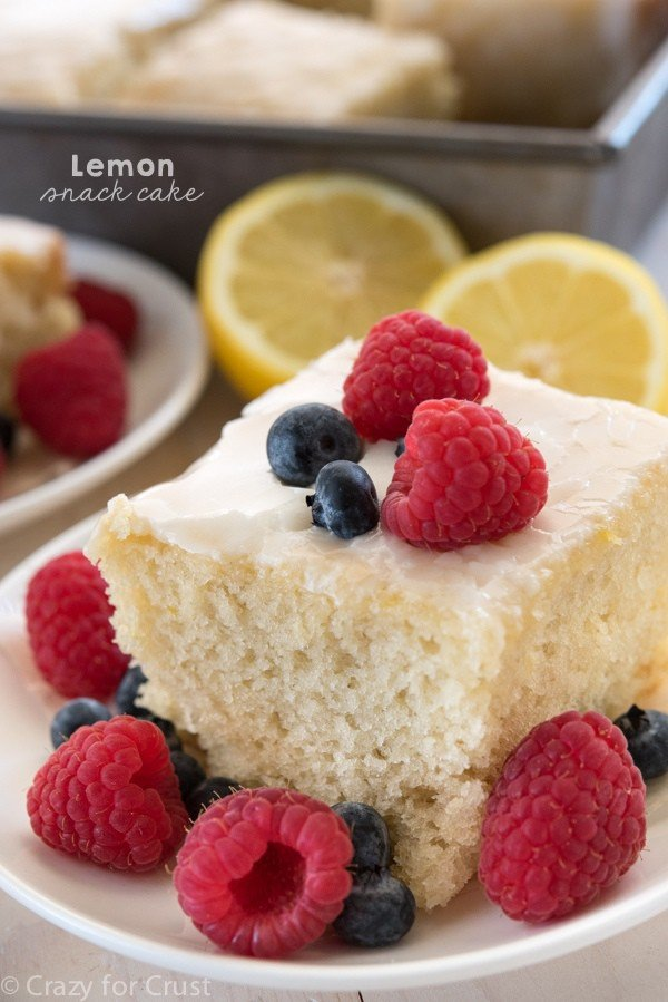 Lemon Snack Cake - an easy and fast lemon cake made with a lemon glaze! Perfect for a potluck or parties or as a simple dessert!