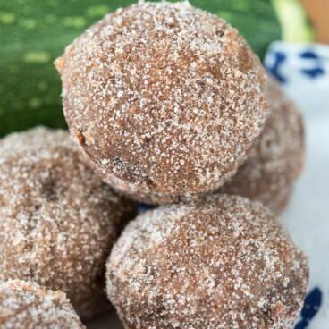 Stack of chocolate zucchini doughnut muffins