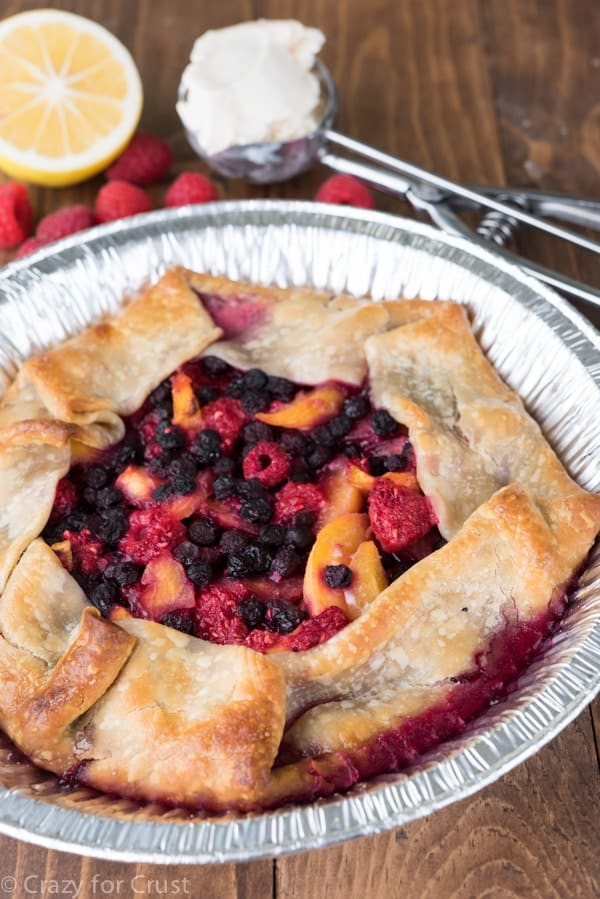 How to grill a mixed berry peach pie! It's an easy recipe all done on the grill - no oven needed!