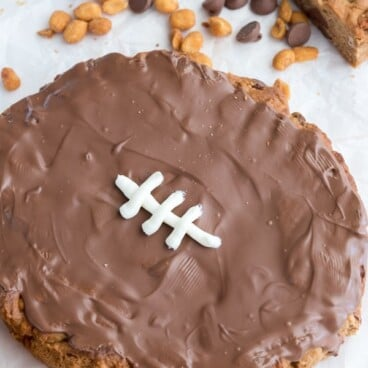 Football Cookie Cake on parchment paper