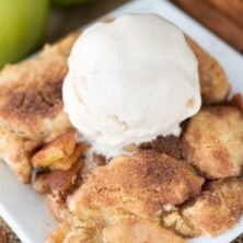Overhead shot of snickerdoodle apple cobbler with vanilla ice cream scoop on top