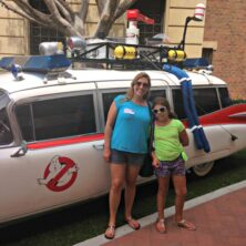 Mom and Daughter in front of the Ghost Busters car at Sony Pictures