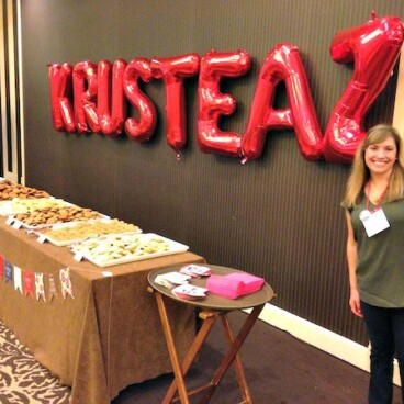 Picture of a women next to a Krusteaz sign