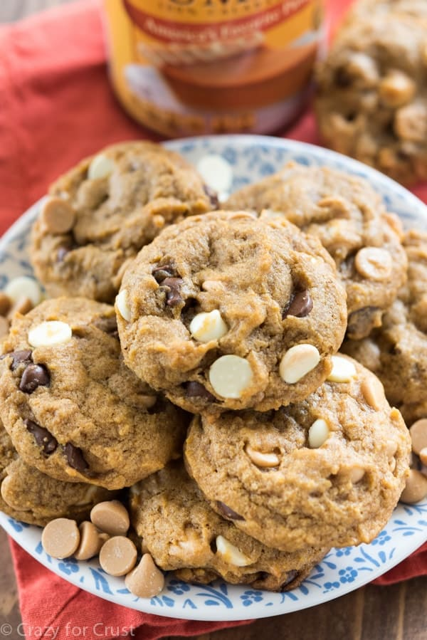 pumpkin cookies with white and chocolate chips on blue patterned plate