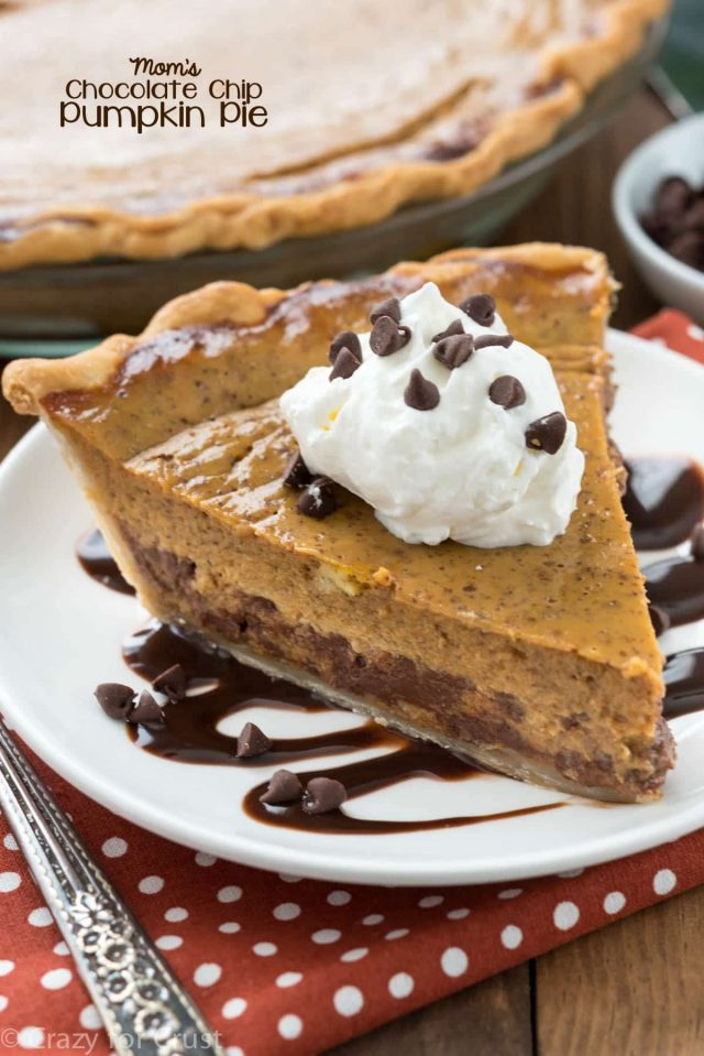 slice of pumpkin pie with chocolate chips on white plate with chocolate sauce