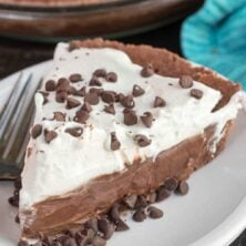 This easy Double Chocolate Cream Pie recipe is made completely from scratch! A chocolate crust, a decadent chocolate cream filling, and fresh whipped cream.