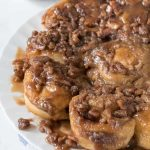 Easy Caramel Pecan Rolls on a white plate