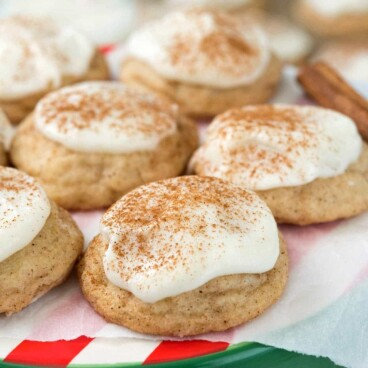 Eggnog Frosted Snickerdoodles on a red and green stand