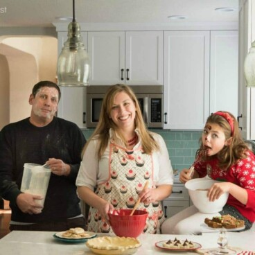 Christmas card picture with a family of 3 in the kitchen