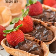 Chocolate Churro Pies topped with fresh strawberries