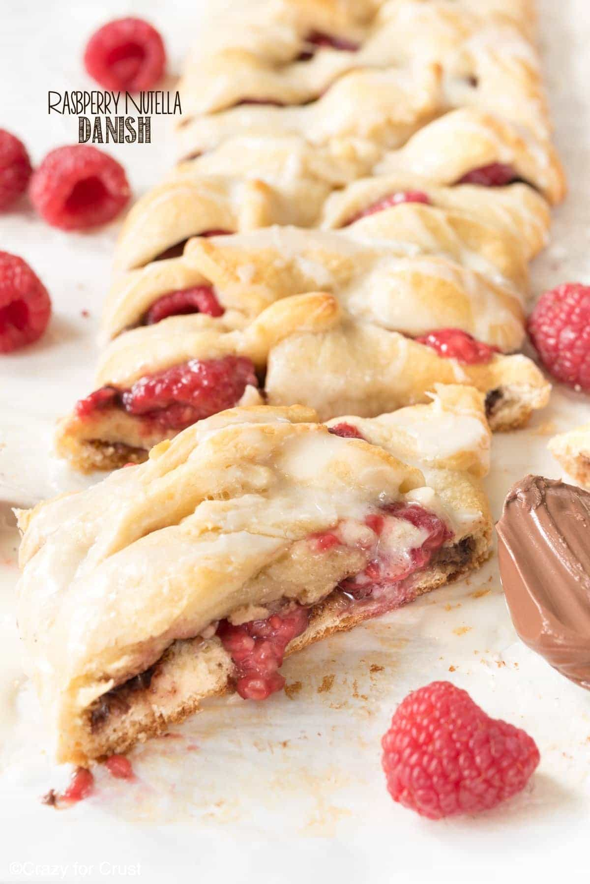 Easy Raspberry Nutella Danish Recipe - this breakfast pastry is so easy to make and is full of Nutella and raspberries!! Only 3 main ingredients and it's on the table in under 30 minutes!
