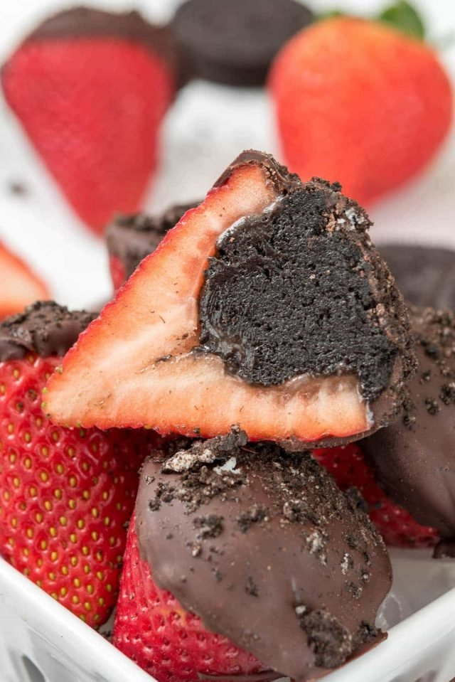 close up of strawberry filled with oreo truffle